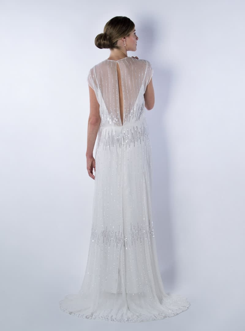 Greta is a wedding dress design by CRISTINA SAURA. It highlights the attractive transparency on its back.