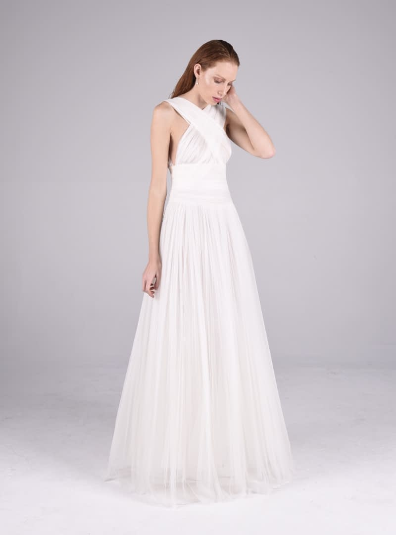 Haute Couture wedding dress designed and built by CRISTINA SAURA and made in silk tulle pleated by hand.