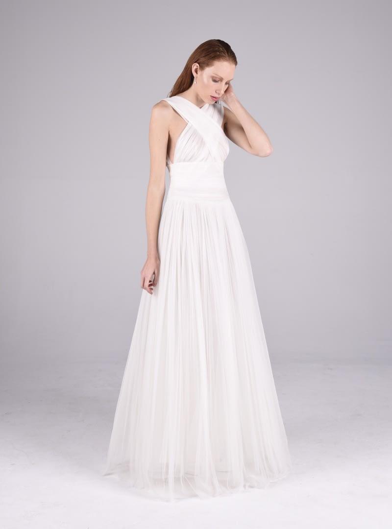 Vestit de núvia d'alta costura dissenyat i construït per CRISTINA SAURA i elaborat en tul de seda prisat a mà.