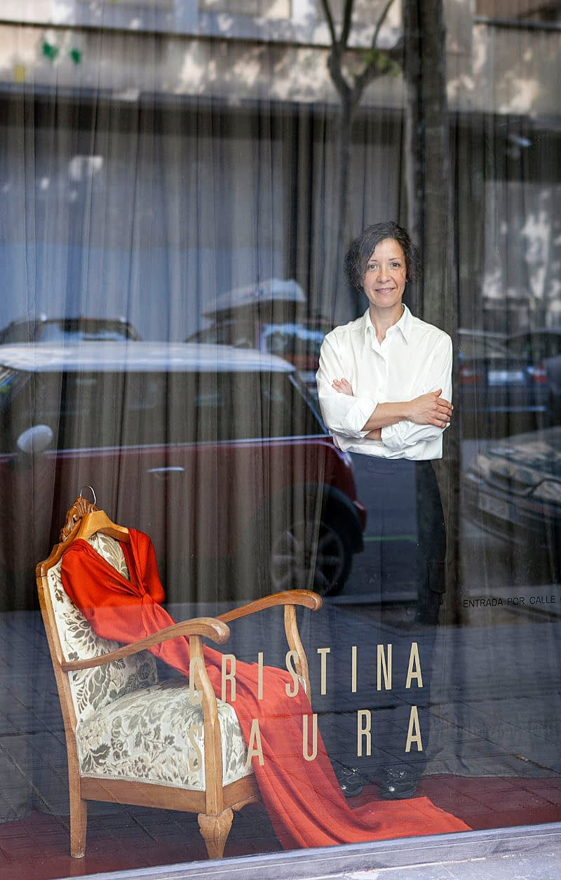 The designer of Haute Couture, Cristina Saura in one of the windows of her shop, in Paseo Picaso 4 in Barcelona.