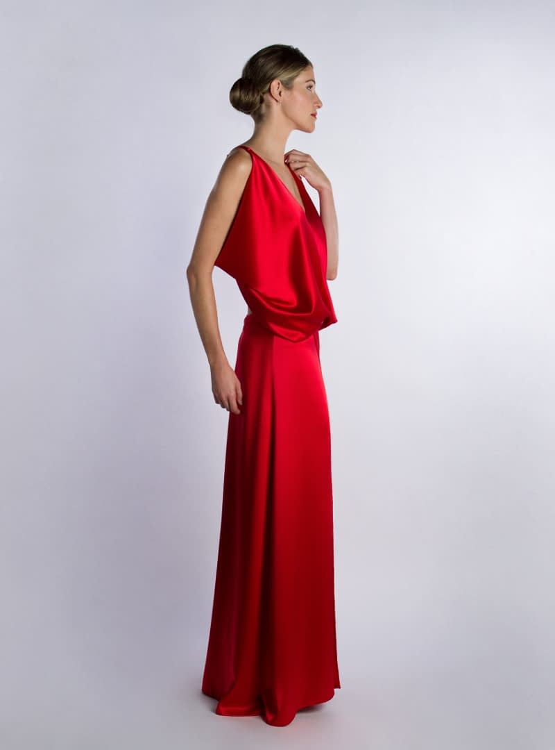 Ariel is a Haute Couture design from the collection of Party Dresses by CRISTINA SAURA. It is elaborated in satin crepe of silk in suggestive red.